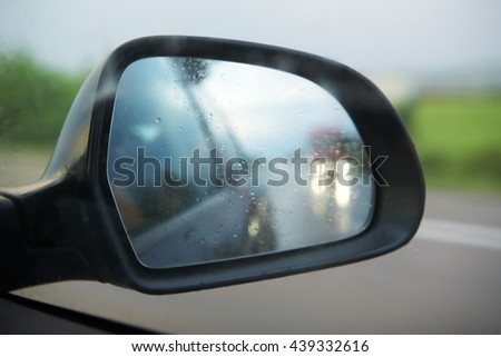 side view mirror reflection other car - stock photo