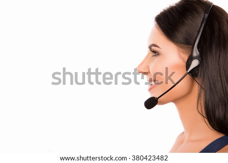 Side view of a beautiful consultant with microphone and headphone - stock photo