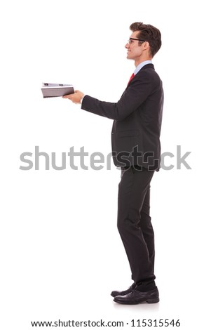 side view of a business man or student looking at something imaginary comming out of his book - stock photo