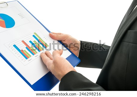Side view of a businessman analysing a set of graphs and holding a map with statistics in his hand, over white. - stock photo