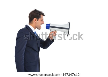 Side view of a businessman shouting on his megaphone on a white background