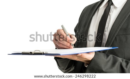 Side view of a businessman signing legal papers on a map with fountain pen, isolated over white background. - stock photo