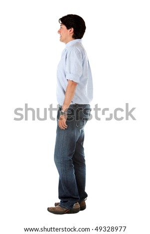 Side view of a casual man standing isolated over a white background - stock photo