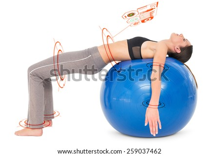 Side view of a fit woman stretching on fitness ball against fitness interface - stock photo