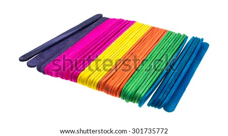 Side view of a group of new colorful craft sticks isolated on a white background. - stock photo