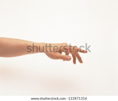 Side view of a hand pointing with an index finger - stock photo
