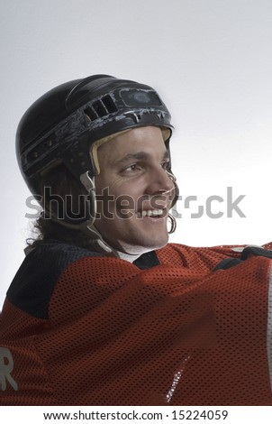Side view of a happy hockey player smiling. Vertically framed photograph - stock photo
