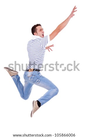 side view of a jumping young casual man on white background - stock photo