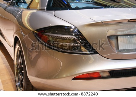 Side view of a luxurious sports car - stock photo