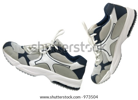 Side view of a pair of athletic sports shoes on white background - stock photo