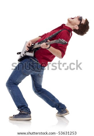 side view of a passionate guitarist playing his electric guitar on white background - stock photo