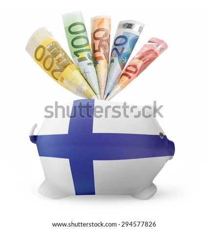 Side view of a piggy bank with the flag design of Finland and various european banknotes.(series) - stock photo