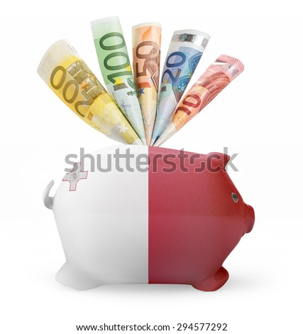 Side view of a piggy bank with the flag design of Malta and various european banknotes.(series) - stock photo
