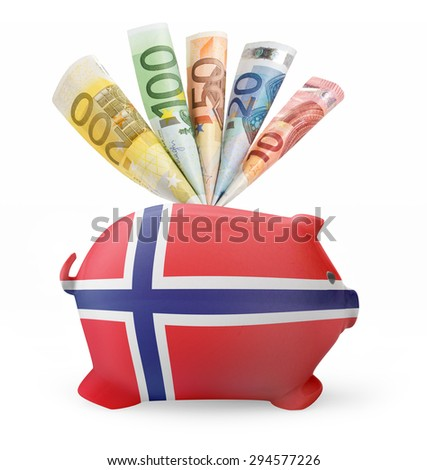Side view of a piggy bank with the flag design of Norway and various european banknotes.(series) - stock photo