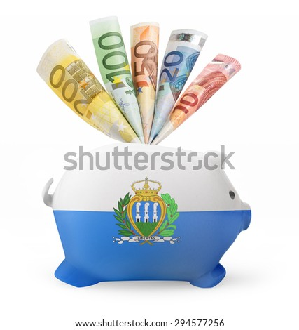 Side view of a piggy bank with the flag design of San Marino and various european banknotes.(series) - stock photo