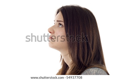 Side view of a sad woman isolated on white, she's looking at the copyspace. - stock photo