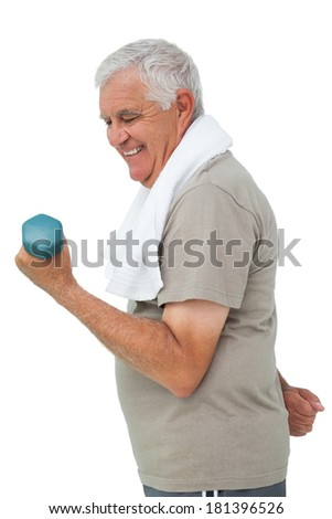 Side view of a senior man exercising with dumbbell over white background - stock photo