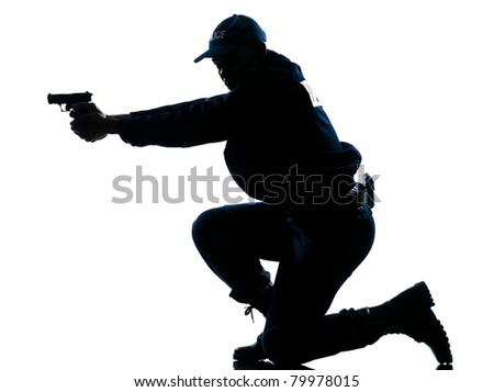 Side view of a silhouetted Afro American police officer aiming gun isolated on white background - stock photo