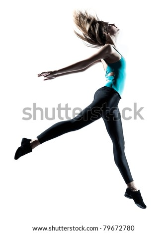 Side view of a sporty young woman jumping isolated on white background - stock photo