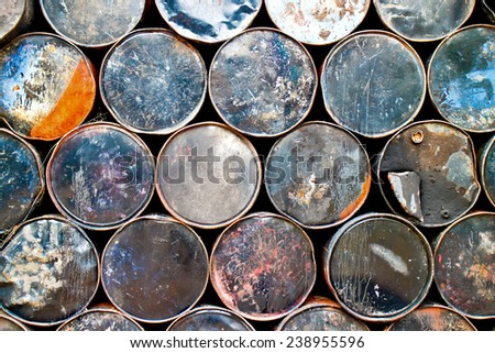 Side view of a stack of used oil drums - stock photo