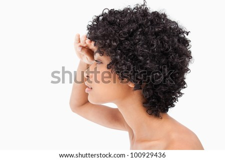 Side view of a teenager placing her hand above her eyes - stock photo
