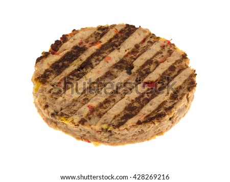 Side view of a veggie burger patty isolated on a white background.  - stock photo
