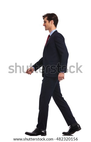 side view of a walking young business man , isolated on white background