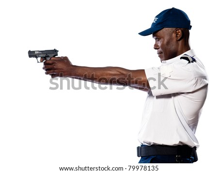 Side view of an afro American police officer aiming gun in studio on white isolated background - stock photo