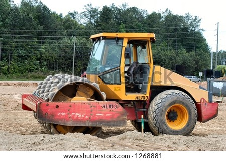 Side view of an earth compactor - stock photo