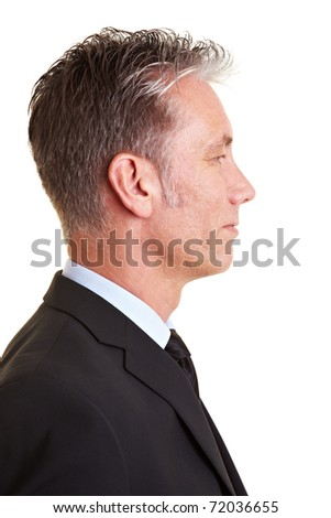 Side view of an elderly business man - stock photo