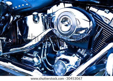 Side view of an engine of motorcycle, with blue tint. - stock photo