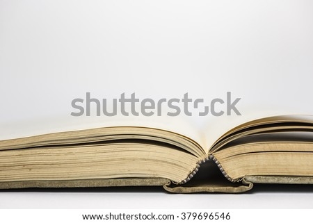 Side view of an open book with space for text above it