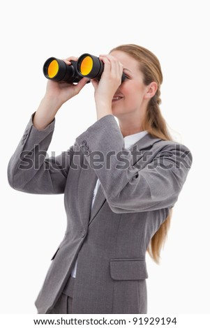 Side view of bank employee with spyglasses against a white background - stock photo