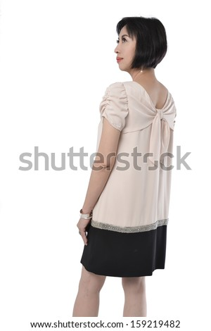 Side view of beautiful Asian woman standing on white background