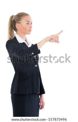 Side view of beautiful blonde businesswoman pointing on white screen