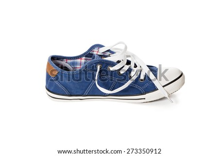 Side view of blue athletic shoe with untied laces on white background