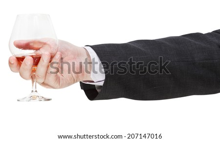 side view of brandy glass in businessman hand isolated on white background - stock photo