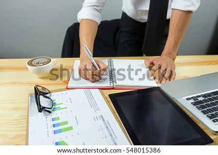 side view of Business man working at office with laptop and documents on his desk at his office while looking serious consultant ,lawyer concept,morning light,vintage color,selective focus
