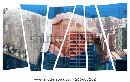 Side view of business peoples hands shaking against city skyline - stock photo