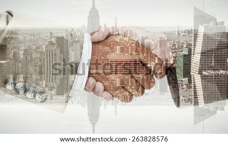 Side view of business peoples hands shaking against room with large window looking on city - stock photo