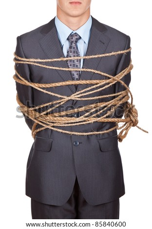 Side view of businessman executive tied up with rope - stock photo