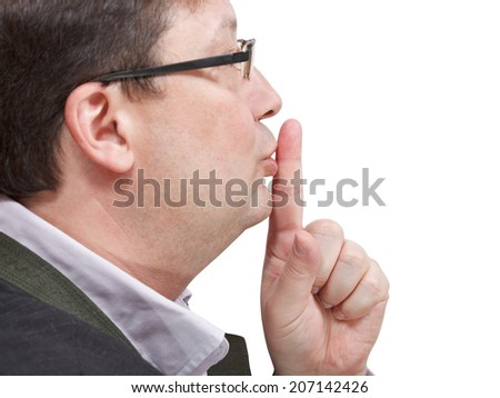 side view of businessman's finger near lips - silence hand gesture isolated on white background - stock photo