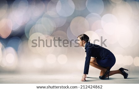 Side view of businesswoman standing in start position - stock photo