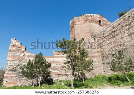 Side view of city walls of Istanbul (Theodosius wall) after partial restoration - stock photo