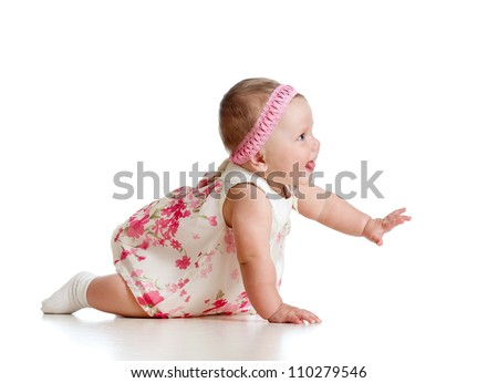side view of crawling baby girl over white - stock photo