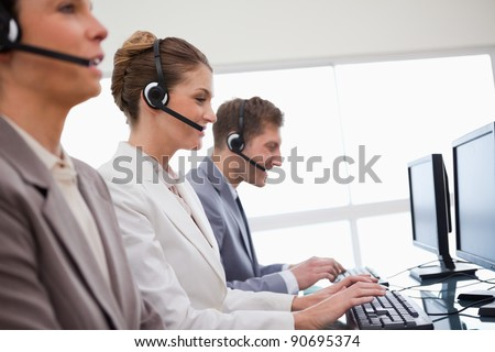 Side view of customer service department at work - stock photo