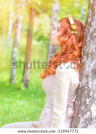Side view of cute dreamy woman looking on the sun, enjoying warm sunny day, fashionable hairstyle, vogue and style concept - stock photo