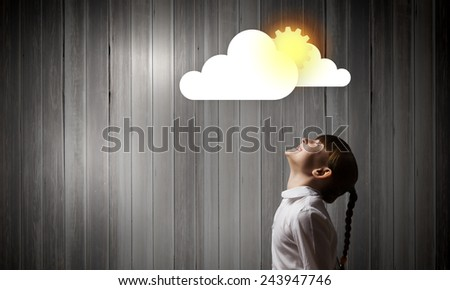 Side view of cute girl and media cloud above her head