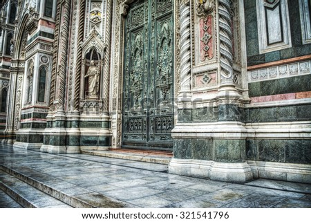 side view of door entrance in Santa Maria del Fiore cathedral, Florence - stock photo