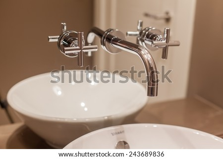 Side view of Faucet and marble sink in the luxury hotel - stock photo